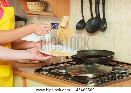 Human Frying Breaded Chicken Cutlet.
