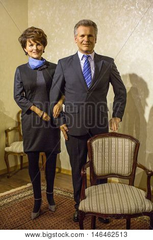 KRAKOW, POLAND - FEB 9, 2016: Aleksander Kwasniewski and Jolanta wax figures of Polonia Wax Museum at Main Square. Wax Museum was opened in 2016, inspired by organization in Krakow World Youth Day.