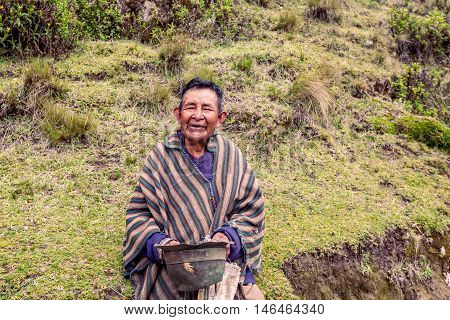 Quilotoa Ecuador - 27 March 2015 Indigenous Villager Smiling At The Camera Near Quilotoa Lake In South America