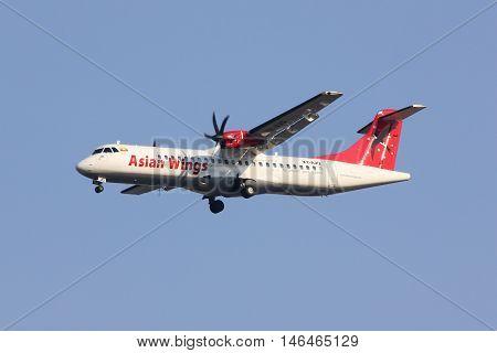 CHIANGMAI THAILAND - FEBRUARY 26 2014: XY-AJQ ATR72-200 of Asian wings. landing to Chiangmai airport from Mandalay ( Myanmar ).