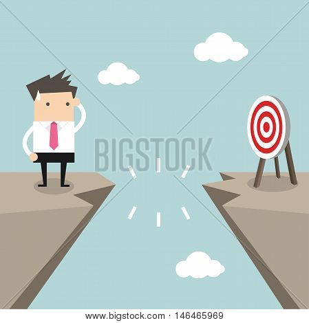 Businessman in front of a gap and looking into the empty space underneath vector