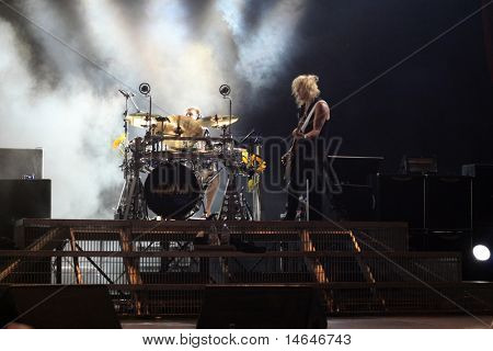 DUBLIN - JUNE 12 : Rick Savage (R) and Rick Allen (L)of Def Leppard rock group on stage during their 2009 tour at The O2 Dublin June 12, 2009 in Dublin.