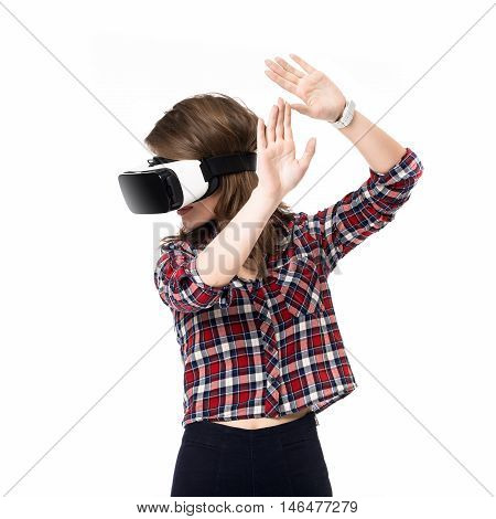 Happy girl getting experience using VR headset glasses of virtual reality, much gesticulating hands, on white background