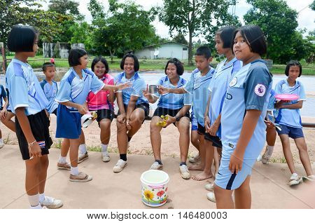 PHITSANULOK THAILAND - AUG 31: During the break sporting events students in rural Thailand.on Aug 31 2016 in Phitsanulok Thailand