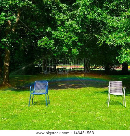 Summer park green lawn garden chairs and an automatic watering system