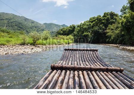 bamboo raft in the stream drift outdoor background