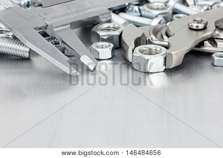 Various Hand Tools And Screws On Scratched Metal Background