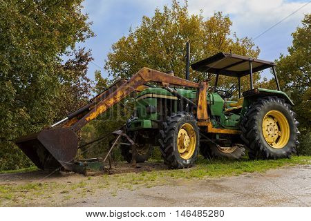 View of an old aged tractor among trees