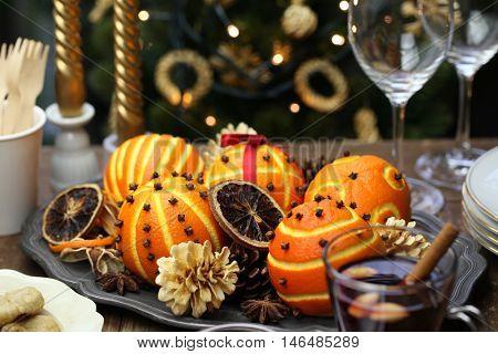 spiced orange pomander balls, scented christmas table decoration