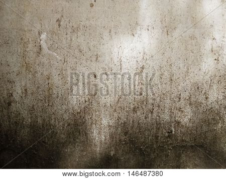 rough aged and decayed concrete surface with dark stains