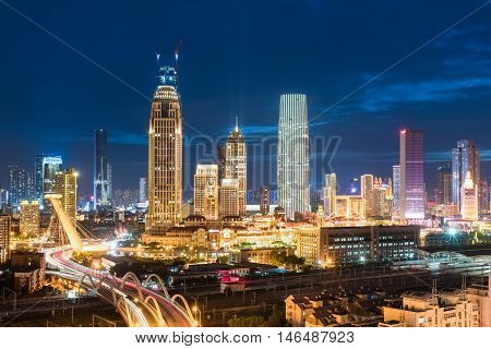tianjin cityscape of skyline with modern buildings and bridge at night