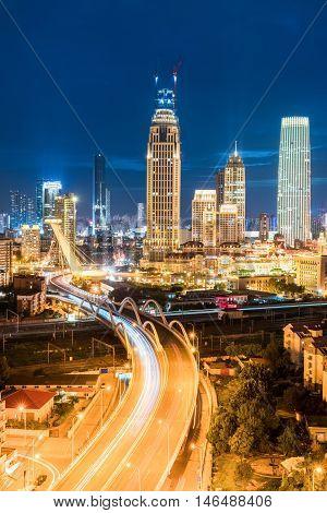modern city night scene in tianjin road bridge with modern buildings china