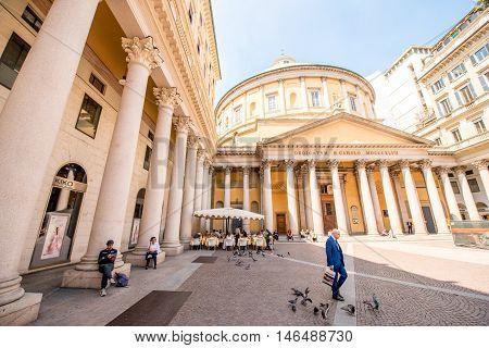 Milan, Italy - June 06, 2016: People walk near San Carlo al Corso neo-classic church in Milan city