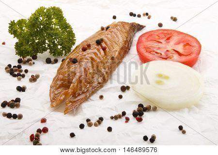 scottish breakfast with smoked mackerel onion tomato and parsley on white kitchen paper