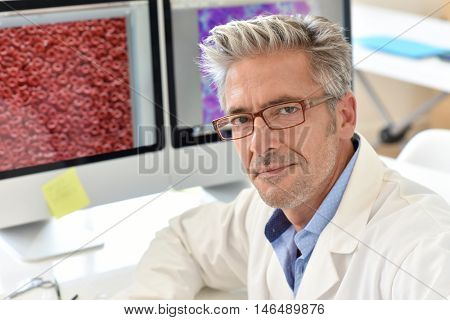 Portrait of microbiology scientist in office