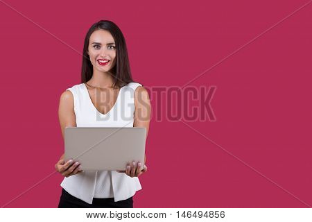 Business Woman With Long Hair Is Holding A Laptop In Both Hands
