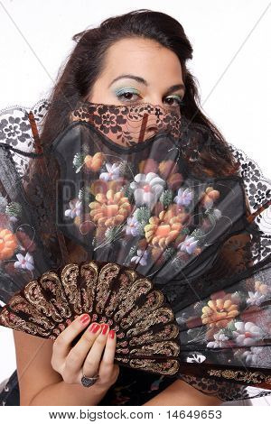 A Spanish beautiful woman behind traditional fan on white background - Focused on the hand