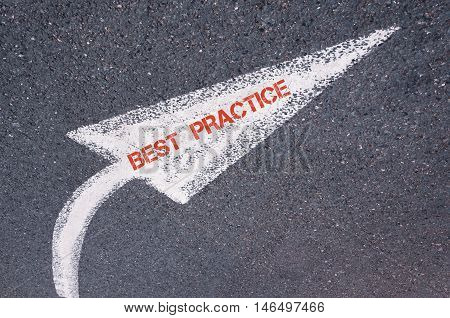 Directional White Painted Arrow With Words Best Practice Over Road Surface