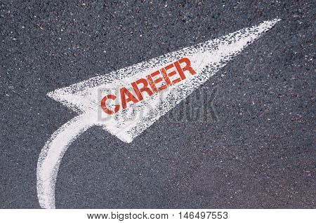 Directional White Painted Arrow With Word Career Over Road Surface