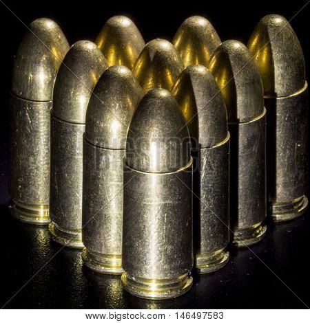 The many gold bullets on black background