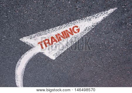 Directional White Painted Arrow With Word Training Over Road Surface