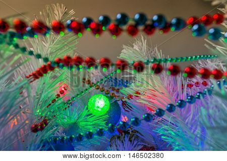 Christmas background for greeting card. Decorated fir tree in the room in the New Year's holiday.