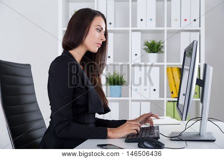 Business Lady In Black Working With Documents