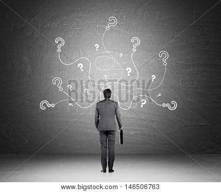 Man With Suit And Question Marks