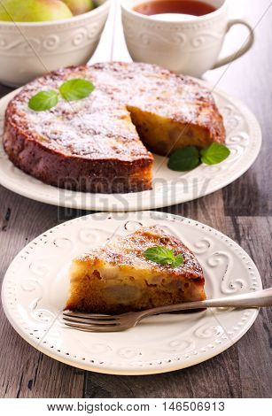 Pear sponge cake with icing sugar on top