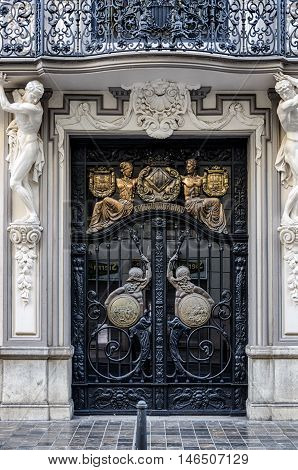 VALENCIA, SPAIN - AUGUST 6, 2016: Interesting hammered door with ancient figures