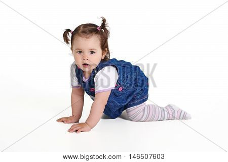 Baby one year old creeps on a white background