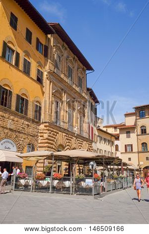 Florence, Italy, June, 25, 2016: cafe on a square infront of Palazzo Vecchio - one of the famoust buildings in Florence, Italy in Florence, Italy