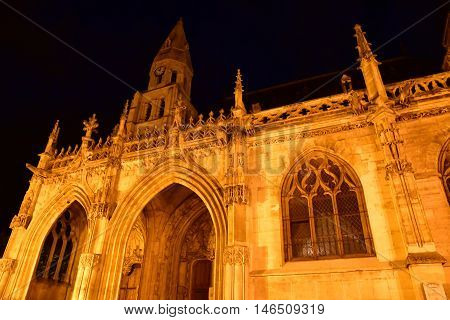 Poissy; France - august 20 2016 : the picturesque collegiate church in the night