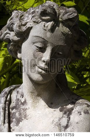 Ancient statue of Demeter, goddess of harvest, agriculture, nature and seasons in greek religion and mythology. Sculpture of one of the Twelve Olympians, major deities of Greek pantheon. Photography.