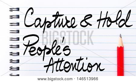 Capture And Hold Peoples Attention Note Written On Notebook Page