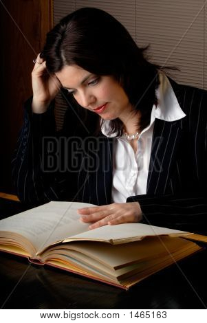 Woman Reading A Law Book