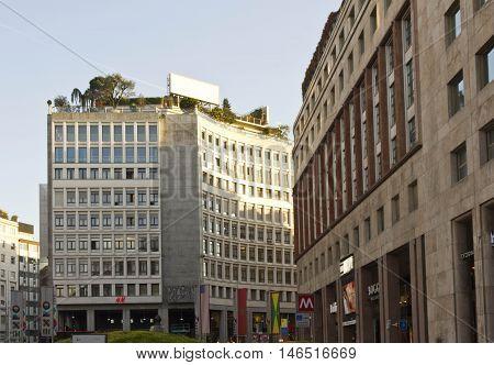 MILAN, ITALY - APRIL 13 2015: Buildings in Piazza San Babila square in Milan at day time