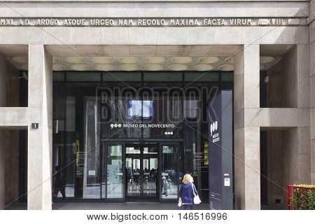 MILAN, ITALY - APRIL 14 2015: Entrance doorway of Museo del Novecento in Milan Italy with a woman in the foreground