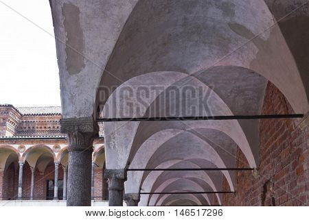 MILAN, ITALY - APRIL 14 2015: Architectural detail of the hallway of lavatory cloister of Milan public University historic building in the city center