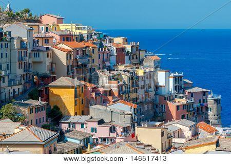 Colorful facades of old medieval Italian village Manarola. Cinque Terre National Park, Liguria, Italy.