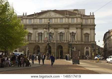 MILAN, ITALY - APRIL 14 2015: La Scala opera house facade in Milan at day time with people around on the square