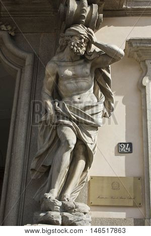 MILAN, ITALY - APRIL 16 2015: Close up of a statue at the entrance of Palazzo Litta in Milan Italy property of the ministry for Art and culture in Milan