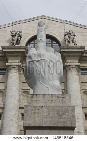 MILAN, ITALY - APRIL 16 2015: Close up of the controversial sculpture by Italian Maurizio Cattelan in front of stock exchange building in Piazza Affari Milan