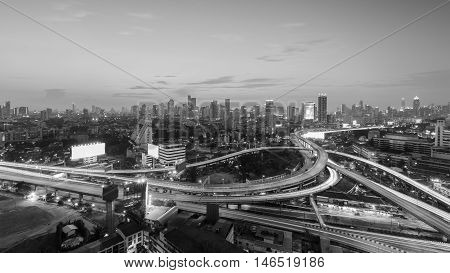 Black and White, highway interchanged with city downtown background