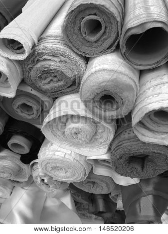 Close up fabric rolls background in monotone