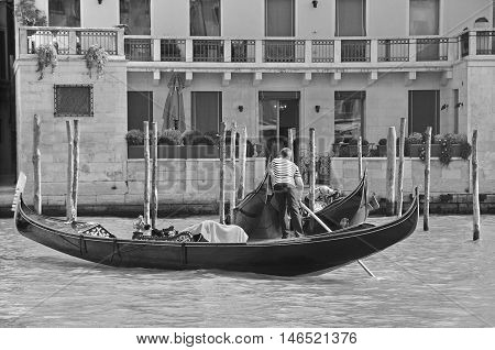 VENICE ITALY JUNE 19 2011:Gondolas, Venice, Italy. The gondola is a traditional, flat-bottomed Venetian rowing boat, well suited to the conditions of the Venetian lagoon