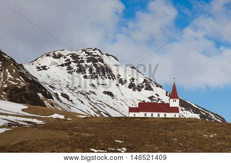 Red church on hill during winter season located in Vik Iceland