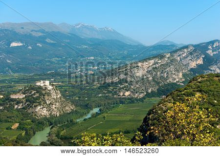 Aerial view of the Adige Valley (Rivoli Veronese) and Peak of Monte Baldo in summer (Baldo Mountain) 2218 m. near the Garda Lake Verona Veneto Italy