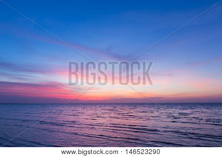 Beautiful sunset sky over seacoast skyline, natural landscape background