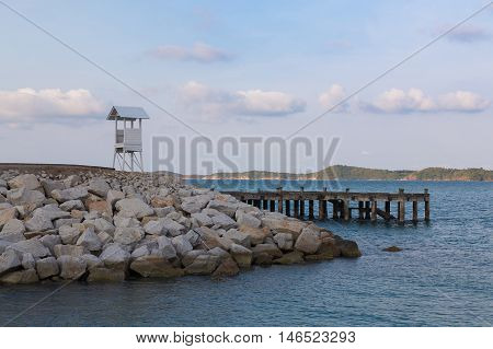 Lifeguard stand over seacoast, natural landscape background
